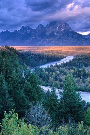 Stock Photo: 1566-712346 Stormy sunrise over the Grand Tetons from the Snake River Overlook, Grand Teton National Park, WYOMING