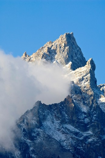 Cloud streaming off Teewinot mountain peak, Grand Teton National Park, Wyoming : Stock Photo
