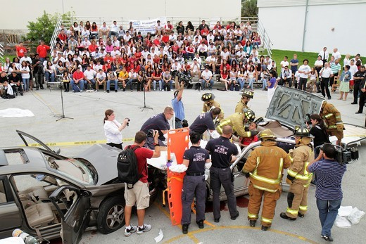 Stock Photo: 1566-714320 Florida, Miami Beach, Miami Beach High School, Cheat the Reaper, DUI simulated automobile accident, drinking, driving, prom, teen, student, acting, death, dead, injury, rescue, audience, Hispanic, girl, female, male, boy,
