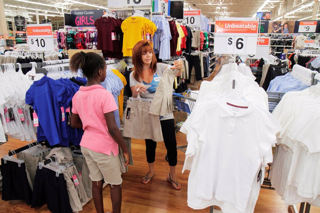 Stock Photo: 1566-714467 Florida, North Miami Beach, Wal-Mart, Walmart, Lions Club Back to School Shopping Spree, shopping, disadvantaged, student, volunteer, school supplies, uniform, charity, Black, girl, Hispanic, woman,