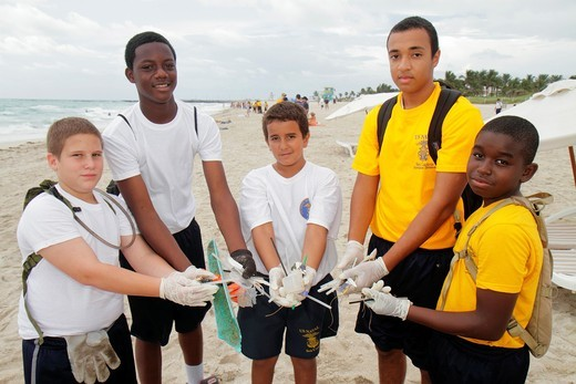 Florida, Miami Beach, Coastal Cleanup Day, volunteer, litter, trash, pollution, student, US Naval Sea Cadets, public beach, pick up, Black, Hispanic, boy, teen, : Stock Photo