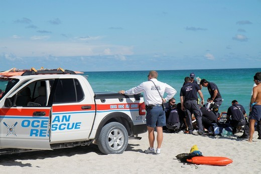 Stock Photo: 1566-714842 Florida, Miami Beach, Atlantic Ocean, fire rescue, emergency, CPR, cardiopulmunary resuscitation, drowning, victim, rough surf, rip currents EMC, medics,