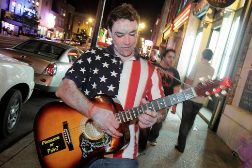Stock Photo: 1566-715253 Tennessee, Nashville, ´Music City USA´, downtown, Lower Broadway, business strip, neon light, sign, honky tonk, man, young adult, Zombie Walk, playing guitar, street performer, night, nightlife,