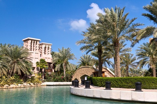 The Madinat Jumeirah with canals and tropical vegetation in Dubai, UAE : Stock Photo