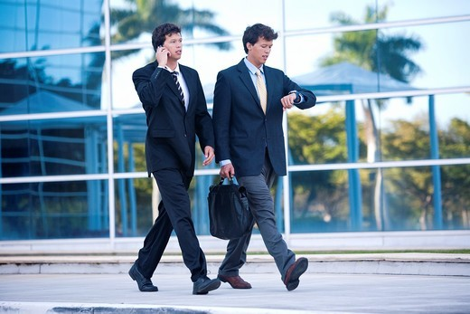 Twin businessmen in a hurry : Stock Photo