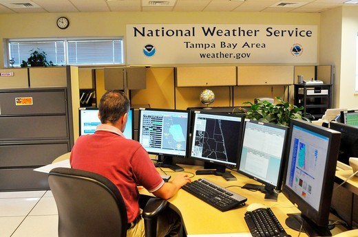 Stock Photo: 1566-724444 Meteorologist in Work Area in Doppler Radar National Oceanic and Atmospheric Administration NOAA National Weather Service Station Ruskin Florida Tampa Hillsborough County Gulf West Central