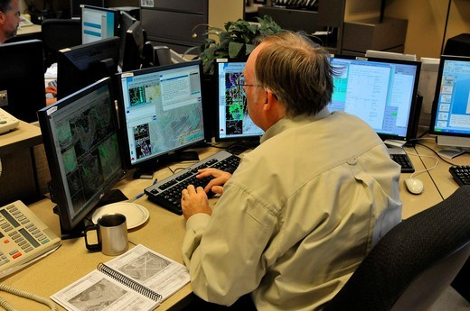Stock Photo: 1566-724466 Meteorologist in Work Area in Doppler Radar National Oceanic and Atmospheric Administration NOAA National Weather Service Station Ruskin Florida Tampa Hillsborough County Gulf West Central
