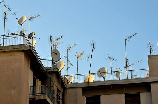 Antennae and satellite dishes on roofs of apartment buildings Athens Greece : Stock Photo