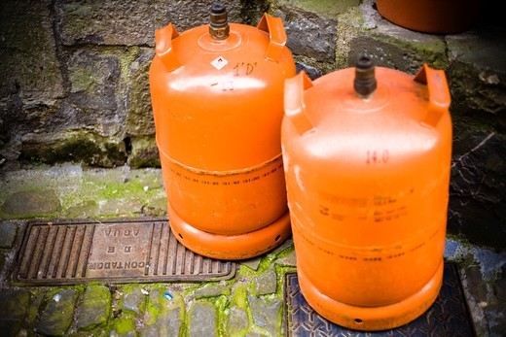 Butano Gas orange container : Stock Photo