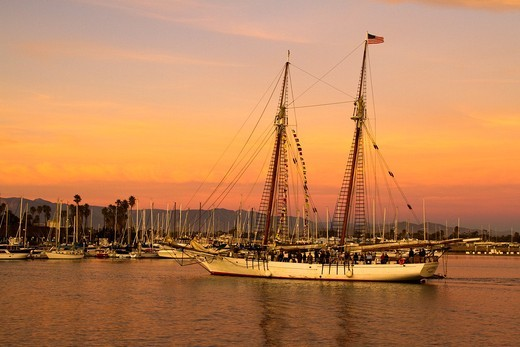 Tall ship entering Channel Islands harbor at sunset : Stock Photo