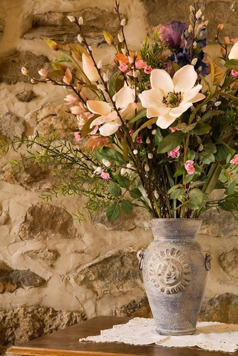 Stock Photo: 1566-727427 Close-up of a Ceramic Flower Vase with Silk Flowers on a Night Table in an Old 1746 Residential Cottage style Fieldstone Home, Quebec, Canada  This image is property released  PR0131