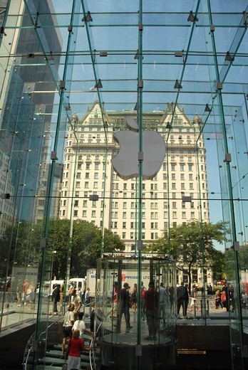 Stock Photo: 1566-729144 The Hotel Plaza through the glass of the Mac Store Fifth Avenue. Midtown West. Manhattan. New York, New York. USA