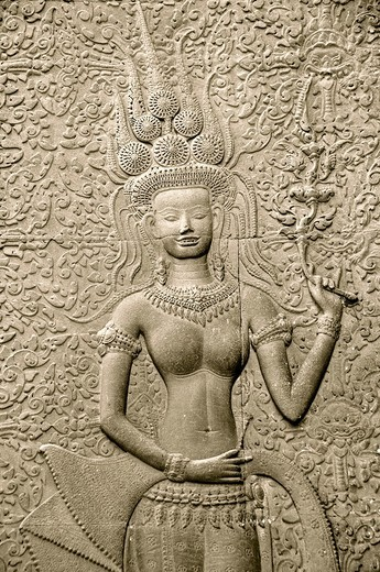 Cambodia, Siem Reap Province, Angkor site listed as World Heritage by UNESCO in 1992, Angkor Wat temple, bas-relief representing apsara dancer carving : Stock Photo