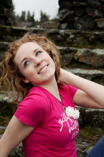 Closeup of a happy young woman outdoors. : Stock Photo