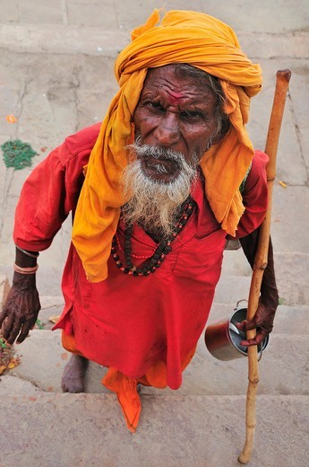 Stock Photo: 1566-734042 Sadhu at the ghat by the Ganges River