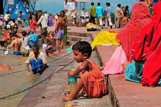 Stock Photo: 1566-734463 Little girl at Har Ki Pairi ghat in the Ganges River