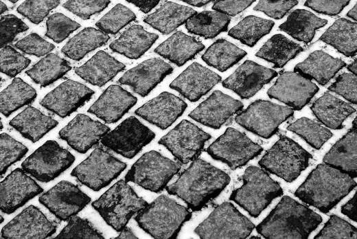 Snow between paving stones in Munich : Stock Photo