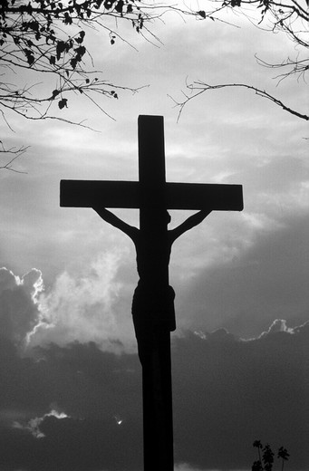 Silhouette of a field cross with Jesus figure : Stock Photo