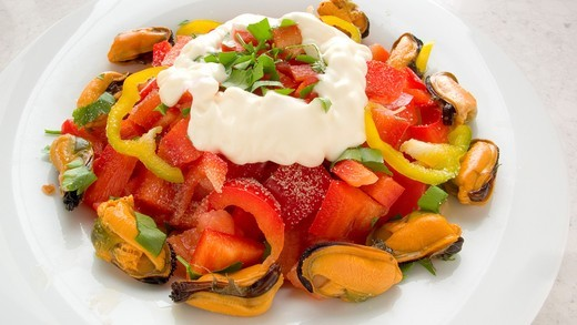 Salad with peppers, mussels and mayonnaise : Stock Photo
