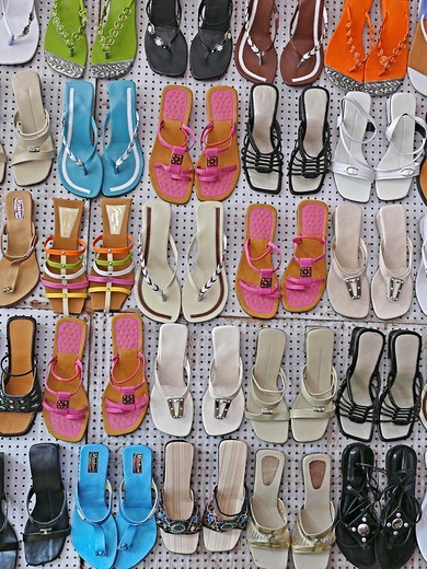 Stock Photo: 1566-739099 Ladies footwear on display outside a shop, Pune, Maharashtra, India