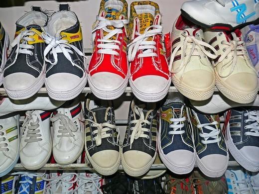 Stock Photo: 1566-739101 Foot wears on display at a shop, Pune, Maharashtra, India