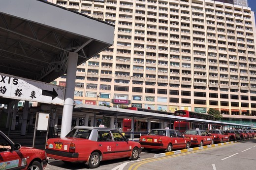 Stock Photo: 1566-740176 Hong Kong: taxis by the Victoria Harbour in Tsim Sha Tsui
