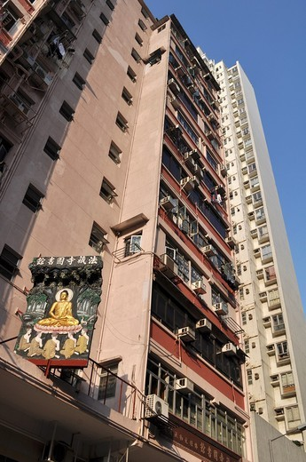 Stock Photo: 1566-740313 Hong Kong: apartment building and Buddhist sign in Kowloon
