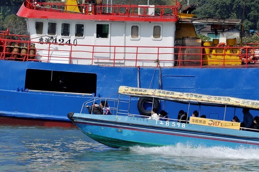 Hong Kong: fast boat for tourists in Tai O village, on Lantau Island : Stock Photo