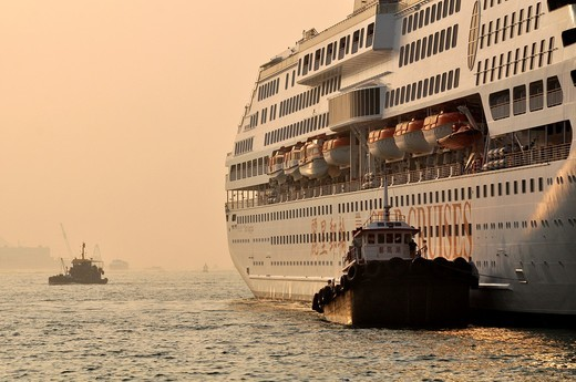 Hong Kong: big cruise ship in Victoria Harbour : Stock Photo