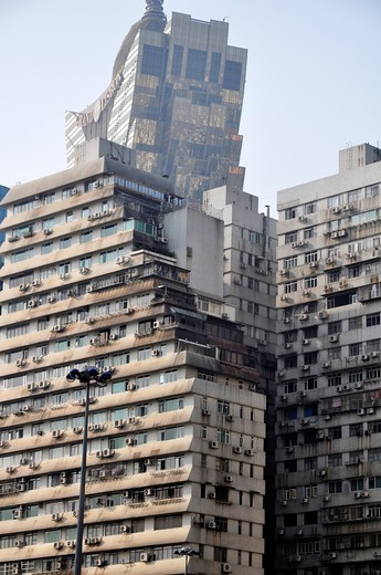 Stock Photo: 1566-740446 Macau: flat apartments buildings and, on the background, the Casino Grand Lisboa