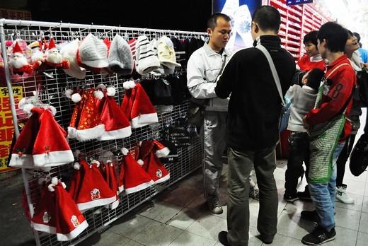 Guangzhou (China): Santa Claus hats sold in Changshoulu during Christmas : Stock Photo