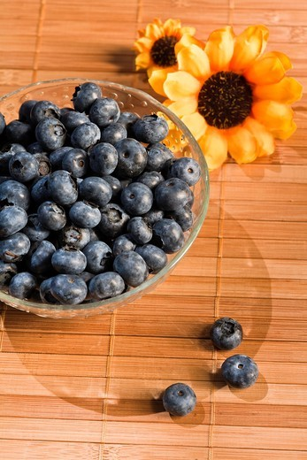 Stock Photo: 1566-744559 A glass bowl filled with blueberries
