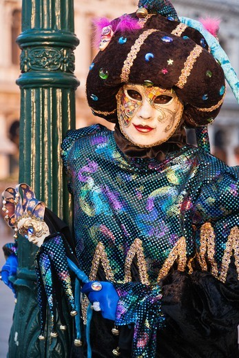 Stock Photo: 1566-744965 A masked harlequin at the carnival in Venice, Italy, Europe