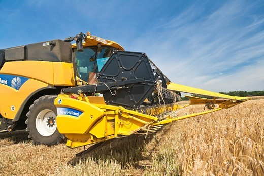 Harvest of a barley field with a harvester in Lower Saxony, Germany, Europe : Stock Photo
