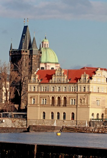 Stock Photo: 1566-745924 Novotneho lavka with Smetana Museum and Old Town Water Tower, Prague from Kampa Park on the Malostana side of Vltava Bridgehead of Charles Bridge is visible with the Old Town Tower bonstructed by Peter Parler Cold November grey goomy day with heavy snow c. Novotneho lavka with Smetana Museum and Old Town Water Tower, Prague from Kampa Park on the Malostana side of Vltava Bridgehead of Charles Bridge is visible with the Old Town Tower bonstructed by Peter Parler Cold November grey goomy day with