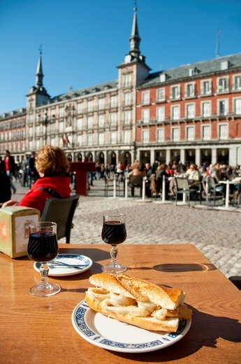Stock Photo: 1566-746839 Fried squids sandwich at Plaza Mayor. Madrid, Spain.
