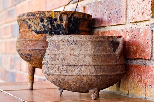 Stock Photo: 1566-752395 Traditional cast iron three-legged cooking pots from South Africa called phutu by indigenous tribes and potjie by Afrikaners