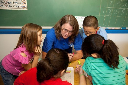Española, New Mexico - Students work on a problem in Kareen Reyer´s fourth grade math class at McCurdy School, a private school supported by the United Methodist Church : Stock Photo