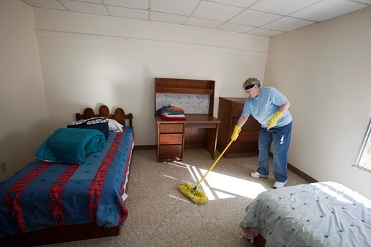 Española, New Mexico - Becky Walker cleans a dormitory room at McCurdy School, a private school supported by the United Methodist Church  She was part of a mission team volunteer group from the Sulphur Grove United Methodist Church near Dayton, Ohio  The. Española, New Mexico - Becky Walker cleans a dormitory room at McCurdy School, a private school supported by the United Methodist Church  She was part of a mission team volunteer group from the Sulphur Grove United Methodist Church near Dayton, : Stock Photo