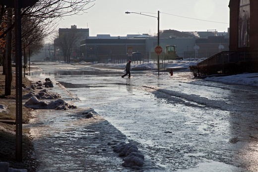 Findlay, Ohio - After heavy rain and snow melt, the Blanchard River overflows its banks, flooding downtown streets : Stock Photo