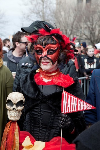 Stock Photo: 1566-752707 Detroit, Michigan - Detroit residents hold the Marche du Nain Rouge to celebrate the coming of spring and to banish the Nain Rouge Red Dwarf from the city  Legend dating from the founding of Detroit 300 years ago says that Le Nain Rouge is an evil spirit. Detroit, Michigan - Detroit residents hold the Marche du Nain Rouge to celebrate the coming of spring and to banish the Nain Rouge Red Dwarf from the city  Legend dating from the founding of Detroit 300 years ago says that Le Nain Rouge is an e