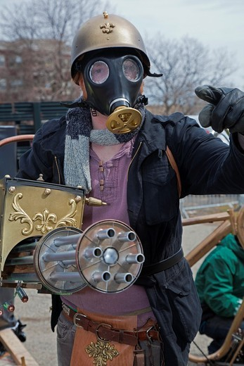 Stock Photo: 1566-752712 Detroit, Michigan - Detroit residents hold the Marche du Nain Rouge to celebrate the coming of spring and to banish the Nain Rouge Red Dwarf from the city  Legend dating from the founding of Detroit 300 years ago says that Le Nain Rouge is an evil spirit. Detroit, Michigan - Detroit residents hold the Marche du Nain Rouge to celebrate the coming of spring and to banish the Nain Rouge Red Dwarf from the city  Legend dating from the founding of Detroit 300 years ago says that Le Nain Rouge is an e
