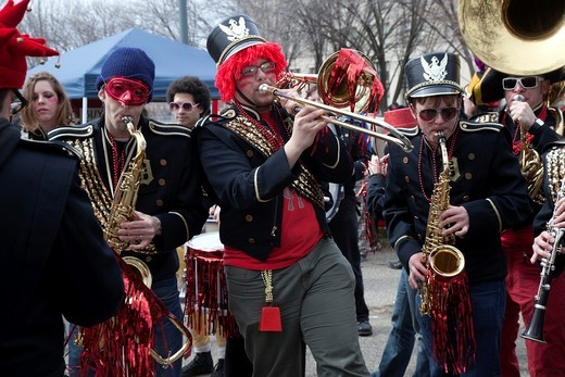 Stock Photo: 1566-752718 Detroit, Michigan - The Detroit Party Marching Band plays as Detroit residents hold the Marche du Nain Rouge to celebrate the coming of spring and to banish the Nain Rouge Red Dwarf from the city  Legend dating from the founding of Detroit 300 years ago s. Detroit, Michigan - The Detroit Party Marching Band plays as Detroit residents hold the Marche du Nain Rouge to celebrate the coming of spring and to banish the Nain Rouge Red Dwarf from the city  Legend dating from the founding of Detroit 300