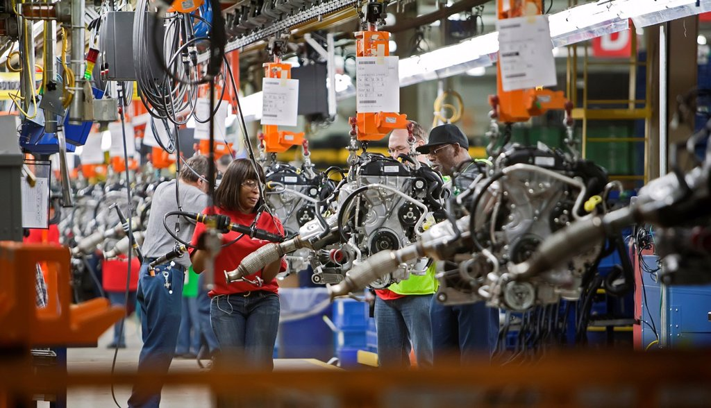 Wayne, Michigan - Workers assemble engines for the 2012 Ford Focus at Ford Motor Co ´s Michigan Assembly Plant  The workers are members of the United Auto Workers : Stock Photo