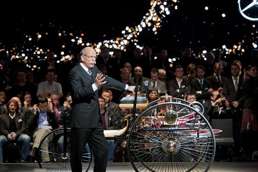 Detroit, Michigan - Dr  Dieter Zetsche with the Benz Patent-Motorwagen, the world´s first motor car, at a Daimler press event at the North American International Auto Show : Stock Photo