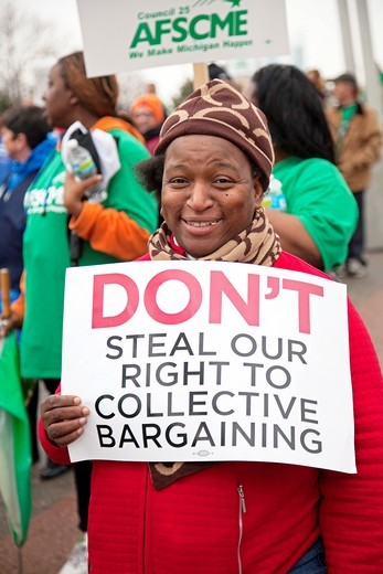 Stock Photo: 1566-752826 Detroit, Michigan - Unions rally in downtown Detroit to support public employees and to oppose state budget cuts  It was one of many ´We Are One´ actions organized across the United States by the labor movement on the anniversary of the assassination of D. Detroit, Michigan - Unions rally in downtown Detroit to support public employees and to oppose state budget cuts  It was one of many ´We Are One´ actions organized across the United States by the labor movement on the anniversary of the assass