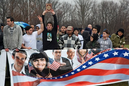 Dearborn, Michigan - A crowd of mostly young Arab-Americans gathered outside the Islamic Center of America in opposition to Rev  Terry Jones, the anti-Islamic Florida pastor who burned the Quran  Jones had planned a demonstration ´against sharia and jihad. Dearborn, Michigan - A crowd of mostly young Arab-Americans gathered outside the Islamic Center of America in opposition to Rev  Terry Jones, the anti-Islamic Florida pastor who burned the Quran  Jones had planned a demonstration ´against shar : Stock Photo