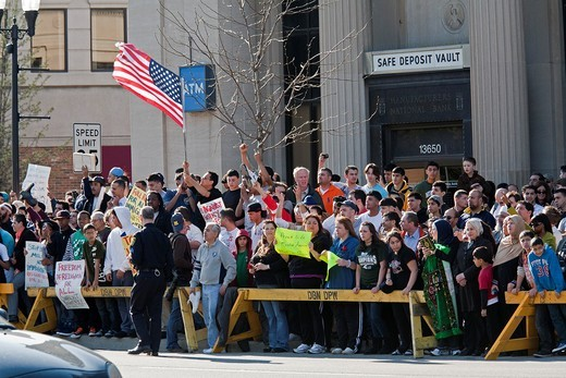 Stock Photo: 1566-752963 Dearborn, Michigan - A crowd of mostly Arab-Americans gathered across the street from Dearborn City Hall to oppose Rev  Terry Jones, the anti-Islamic Florida pastor who burned the Quran  Jones held a demonstration ´against sharia and jihad ´