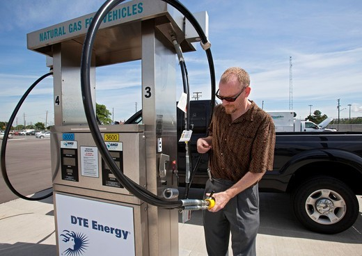 Melvindale, Michigan - A man fills his his pickup truck with compressed natural gas at a natural gas filling station operated by DTE Energy : Stock Photo