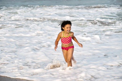 Young girl enjoys the ocean water, Cape Cod, MA, USA : Stock Photo
